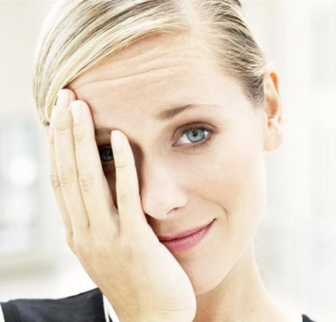 Embarrassed businesswoman